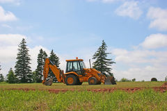 Country Backhoe. Backhoe sitting in a country field stock images