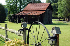 Country barn. A country barn and fence with wagon wheel door stock images