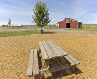 The country barn and picnic bench. Country barn picnic table and yard in a countryside Stock Photos