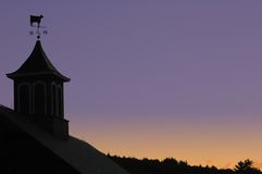 Country barn and sunset. Barn with weathervane at sunset royalty free stock photo