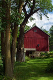 Country Barn and Trees Stock Photography