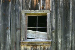 Country Barn Window. Broken window in a rustic country barn royalty free stock image