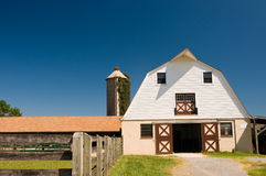 Country barnyard and silo. A view of a classic country barnyard and ivy-covered silo on a small dairy farm.  Gambrel style barn Stock Images