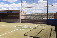 Country Baseball Field. Angled toward visitor`s dugout and home plate Royalty Free Stock Images