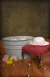 Country Bath Time. Country Old Fashioned wash tub with girl hat, rubber duck, soap and bubbles royalty free stock photos