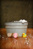 Country Bath Time. Country Old Fashioned wash tub rubber duck, soap and bubbles royalty free stock photography