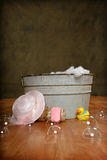 Country Bath Time. Country Old Fashioned wash tub with girl hat, rubber duck, soap and bubbles stock photography