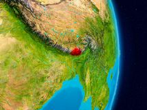 Bhutan from space. Country of Bhutan in red on planet Earth. 3D illustration. Elements of this image furnished by NASA Royalty Free Stock Images