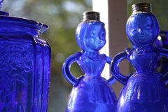Country blue glass ladies. Close up of glass syrup bottles in a country general store in Cape Cod royalty free stock images