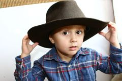 Country boy. Young boy playing in a cowboy hat Stock Photos
