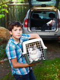 Country boy with cat in carrier going to travel car Stock Photos