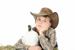 Country boy with farm animal royalty free stock photography