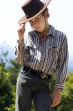Country boy tipping his hat. A courteous country boy in denim jeans and button shirt tips his hat Royalty Free Stock Photos