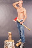 Country boy whittling with an axe Stock Photos