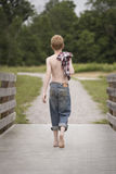 Country boy on a wooden bridge Royalty Free Stock Photo