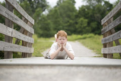 Country boy on a wooden fence Stock Images