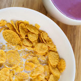 A country breakfast with blueberry  yogurt, milk and cornflakes Royalty Free Stock Image