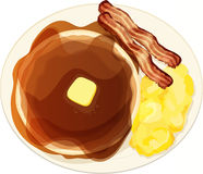 Country Breakfast Plate. A plate with pancakes and syrup, bacon strips, and scrambled eggs Stock Photography