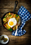 Country breakfast from potatoes, with bacon and fried eggs Stock Photography