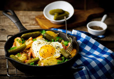 Country breakfast from potatoes, with bacon and fried eggs Stock Photos