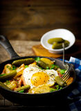 Country breakfast from potatoes, with bacon and fried eggs Stock Photo
