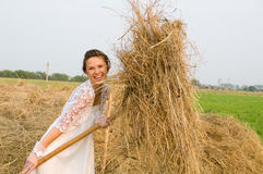 Country  bride on haystack Royalty Free Stock Photography