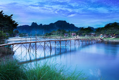 Country bridge across Nam Song river, Vang Vieng, Laos. Vang Vieng is a tourism-oriented riverside town and backpacker's paradise in Vientiane Province stock photo