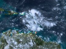 Night view of Caribbean. Country of Caribbean in red on planet Earth with clouds at night. 3D illustration. Elements of this image furnished by NASA Stock Photography
