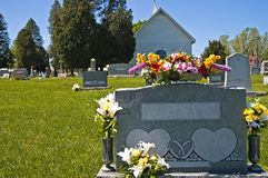 Country Cemetery. Small community cemetery behind a country church Stock Image