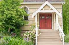 Country chapel doorway. A view of a country chapel doorway with steps and landscaping Royalty Free Stock Photos