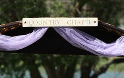 A country chapel wood sign. A handmade county chapel wooden sign for a wedding stock photos