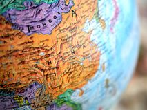 Country of China  focus macro shot on globe map for travel blogs, social media, website banners and backgrounds. Country of China  focus macro shot on globe map Royalty Free Stock Photography