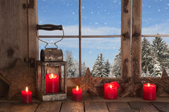 Country Christmas decoration: wooden window decorated with red c Stock Photos