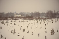 Country chruch in winter - aged photo Royalty Free Stock Photography