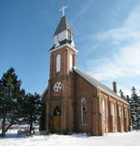Country Church. Pretty little brick country church in a snowy winter setting, Ontario, Canada Stock Photo