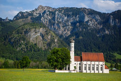 Country Church. A photo of a church in Bavaria, Germany. The photo has a mountain background Royalty Free Stock Image
