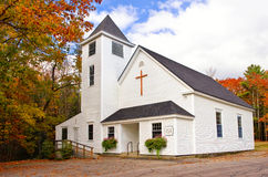 Country church. White country church against autumn trees in New England Royalty Free Stock Photography