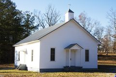 Country Church. Old rural white church on country road in southern U.S stock photo