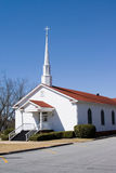 Country Church. Quiet rural small church with cross and steeple royalty free stock images