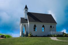 Country Church Americana on hill under blue sky. Morning scenery of a lovely church on the San Juan Island of Washington state, USA. Countyside rural setting stock photos