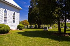 Country Church and Cemetery. Quiet country church with a community cemetery behind it Stock Photo