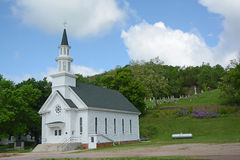 Country Church with Cemetery. A rural church with a cemetery on a hill Stock Photos