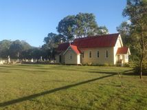Country church and cemetery. Sunny day Stock Photo
