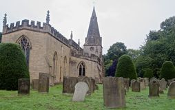 Country church and graveyard. St Anne's church in Baslow, a village in the Peak District of Derbyshire, with adjacent graveyard containing yew trees. Tower stock photos