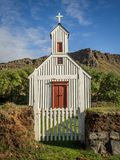 Country Church in Iceland. Small, white country church with a gate and steeple in Iceland Royalty Free Stock Photography