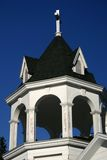 Country Church Steeple. The steeple of a white country church against a deep blue sky royalty free stock image