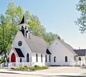 Country Church With Steeple, Small Town America. Lutheran church on a sunny summer morning before service in High River, Alberta, Canada stock images