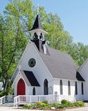 Country Church With Steeple, Small Town America. Lutheran church on a sunny summer morning before service in High River, Alberta, Canada royalty free stock images