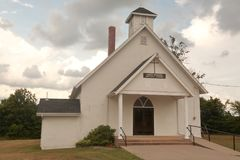 Country church under storm clouds Royalty Free Stock Photography