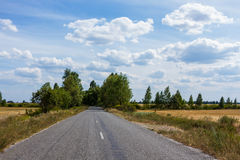 Country cloudy road. Country road and cloudy sky background Stock Photos
